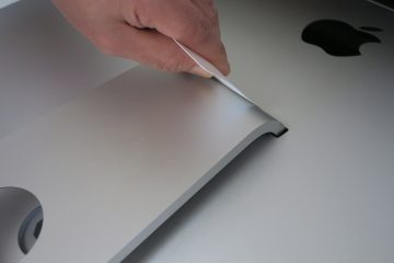 Insert access tool to release iMac stand hinge